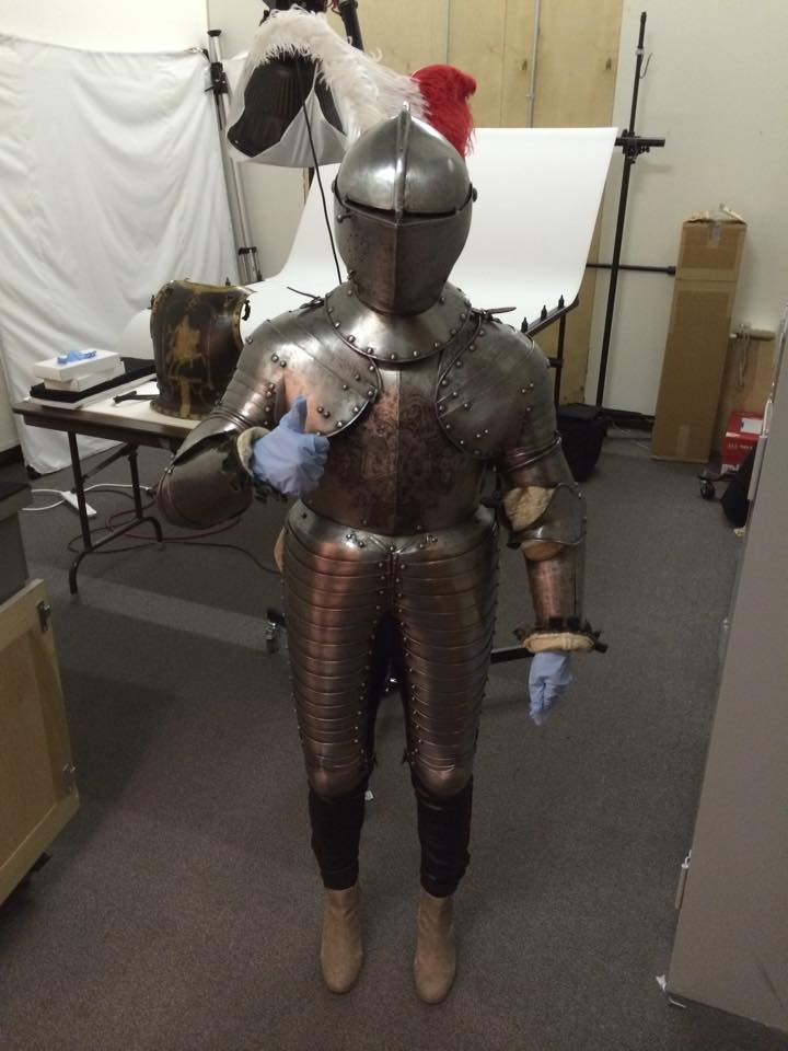 Hlebinsky wearing armor from the Art Institute of Chicago's educational collection